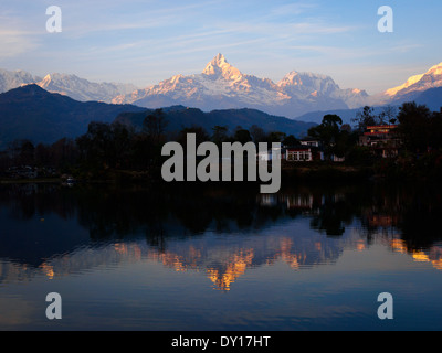 Reflections of the Annapurna Range in Phewa Lake, Pokhara, at sunset, Nepal - Stock Photo