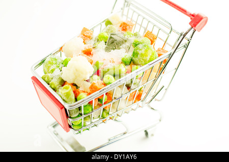Mixture of frozen vegetables, carrots, peas, broccoli, green beans, Brussels sprouts, cauliflower are shopping carts - Stock Photo