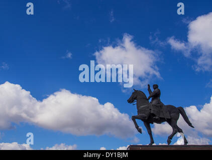 Monument Kliment Voroshilov on a horse on a background of blue sky with white clouds. Marshal Voroshilov was born - Stock Photo
