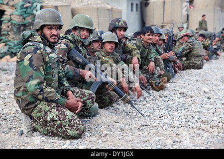 Afghan National Army soldiers wait outside during a meeting at Forward Operating Base Boris March 31, 2014 in Bermal - Stock Photo
