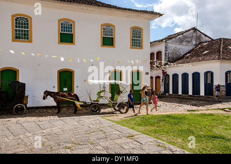 Paraty, colonial town, typical colonial houses, horse cart with tourists, Rio de Janeiro, Costa Verde, Brazil - Stock Photo