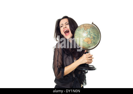 Young woman with an old globe isolated on white background - Stock Photo