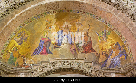 Venice - mosaic from st. Mark cathedral over the main portal. Jesus the King in the heaven and hl. Mary and st. - Stock Photo