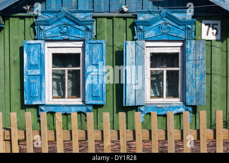 Windows with traditional wooden shutters in Bolshoe Goloustnoe on the shore of Lake Baikal, Siberia, Russia - Stock Photo