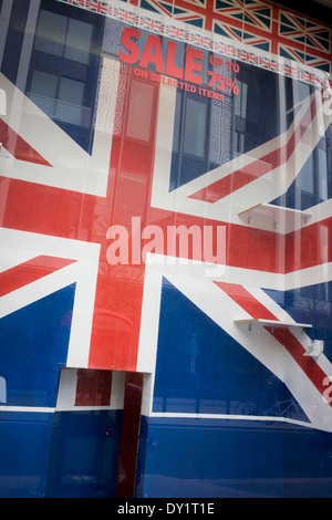 British Union jack flags-themed tourist window, now closed with displays removed after recent sale. - Stock Photo