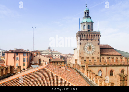 Clock tower of the Palazzo Comunale in Piazza Maggiore, Bologna, Emilia Romagna, Italy - Stock Photo