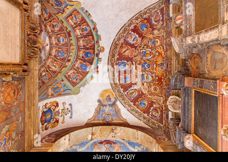 BOLOGNA, ITALY - MARCH 15, 2014: Ceiling and walls of entry to external atrium of Archiginnasio. - Stock Photo