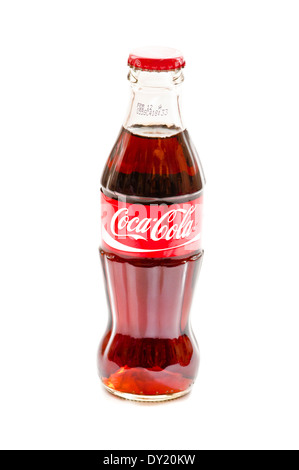 Small Coca-Cola Bottle Isolated on white Background - Stock Photo
