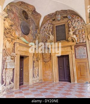 BOLOGNA, ITALY - MARCH 15, 2014: Portals from External atrium of Archiginnasio - Stock Photo