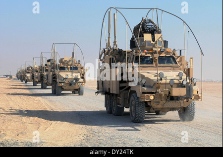 A convoy of US Army Caiman Plus mine-resistant, ambush-protected vehicle, or MRAP carrying soldiers with the 3rd - Stock Photo