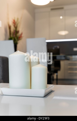 Three Candles with defocus modern interior design in background - Stock Photo