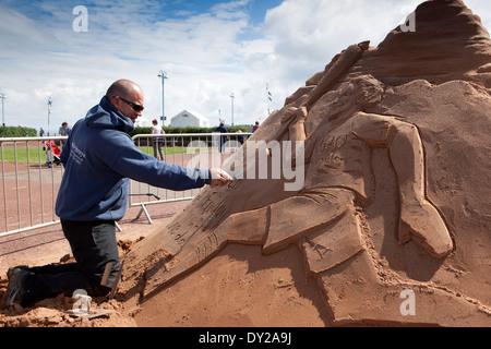 UK, England, Lancashire, Morecambe, Sandcastle Festival professional ice and sand carver Daniel Glover - Stock Photo
