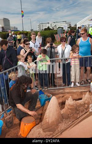 UK, England, Lancashire, Morecambe, Sandcastle Festival professional sand carver Andy Moss at work - Stock Photo