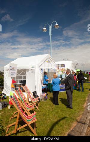 UK, England, Lancashire, Morecambe, Sandcastle Festival deckchairs outside judge's tent - Stock Photo