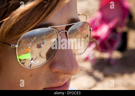 UK, England, Lancashire, Morecambe, Sandcastle Festival, beach reflected in sunglasses - Stock Photo