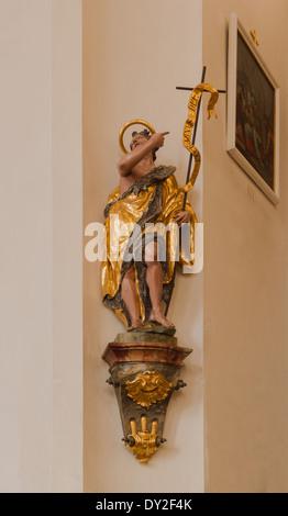 Statue of Saint John the Baptist, church Saint Peter Saint Paul, Oberammergau, Bavaria, Germany. - Stock Photo
