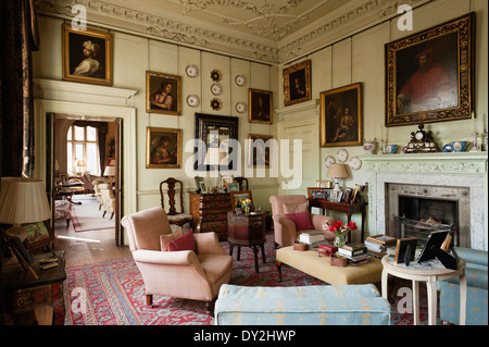 Living Room With Gilt Framed Portraits, Stucco Ceiling And Assorted Antique  Furniture Items   Stock