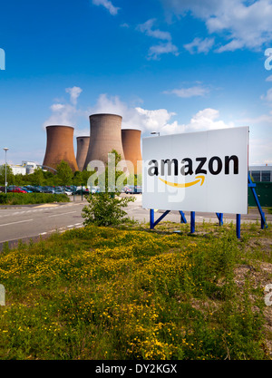 Sign outside the entrance to  Amazon UK warehouse in Rugeley Staffordshire next to cooling towers of coal fired - Stock Photo