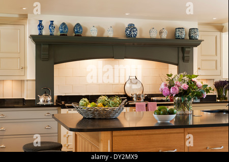 large oak island unit with honed granite surface in kitchen with stock photo royalty free image. Black Bedroom Furniture Sets. Home Design Ideas