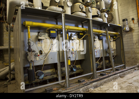 Industrial gas boiler & pipe work controls in major building - Stock Photo