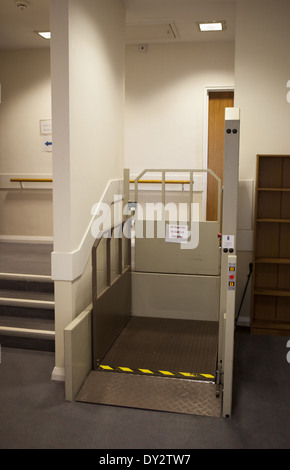 Wheelchair lift installation to assist disabled in care home - Stock Photo