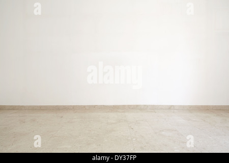 Empty room with marble floor and white wall - Stock Photo