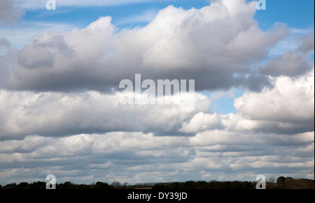 Banks of heavy cumulus clouds in a line across the sky, Alderton, Suffolk, England - Stock Photo