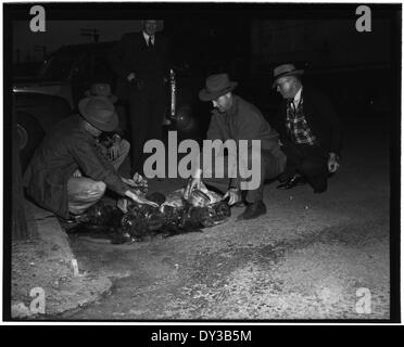 Federal Officers Dumping Whiskey, Crystal Springs, 1-15-1951 - Stock Photo