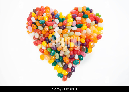 Heart formed out of jelly beans on a clean white backdrop: Sweetheart