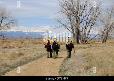 Commerce City, Colorado USA - 5th April 2014. Members of the Boulder Fire Department walk back to their vehicle - Stock Photo