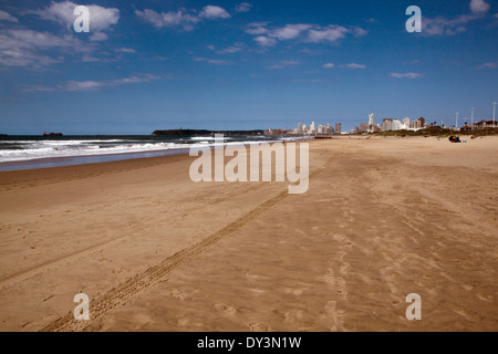 tire tracks on beach in Durban South Africa - Stock Photo