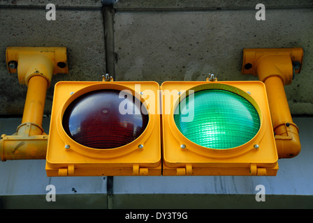 A traffic light at a parking garage is illuminated green, for go. - Stock Photo