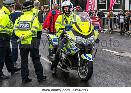Sheffield, UK. 6th April, 2014. Police bike and police officers in high visibility clothing, ready to lead off the - Stock Photo