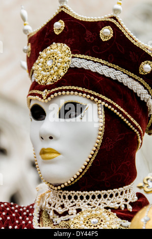 VENICE, ITALY - FEBRUARY 10, 2013: Unidentified person with Venetian carnival mask in Venice, Italy. At 2013 it - Stock Photo