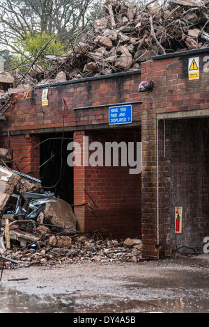 Piles of rubble and twisted metal on a demolition site - Stock Photo
