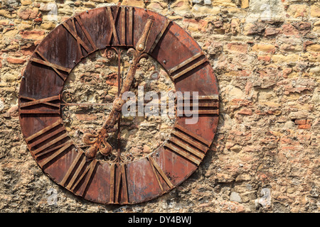 A rusty old clock on a stone wall in Zagreb, Croatia - Stock Photo