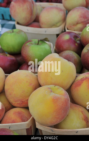 Peaches and Apples on Sale at Farmers Market - Stock Photo