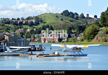 kayakers paddle past seaplanes at Waldo Point in Sausalito - Stock Photo