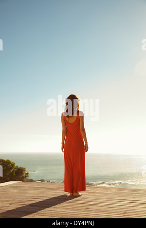 Back View of Woman Looking at the Ocean - Stock Photo