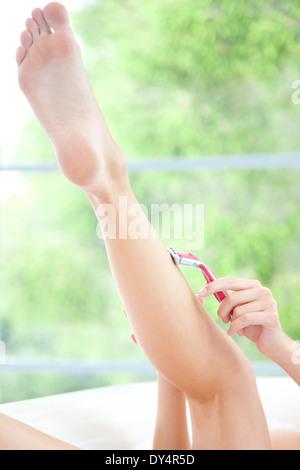 Woman Shaving Leg, Close-up View - Stock Photo