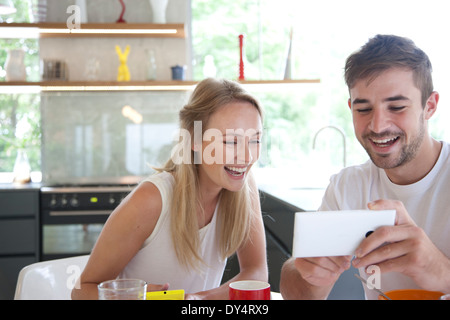 Couple at Breakfast Using Smartphone - Stock Photo