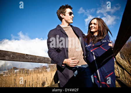 Romantic couple strolling on footbridge - Stock Photo