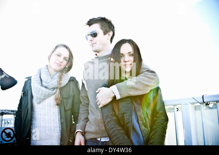 Portrait of one male and two female adult friends - Stock Photo