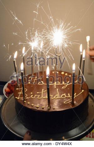 Chocolate Birthday Cake with single candle Stock Photo Royalty