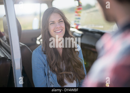Young woman with long brown hair, smiling - Stock Photo