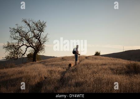 Mature man and his basset hound walking in Santa Monica Mountains, California, USA - Stock Photo
