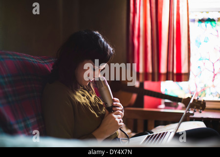 Woman with microphone and laptop - Stock Photo