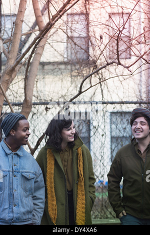 Young adults standing outdoors - Stock Photo