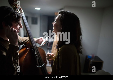 Musicians listening to music on smartphone - Stock Photo