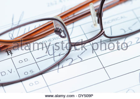 Spectacles and eye testing form document - Stock Photo